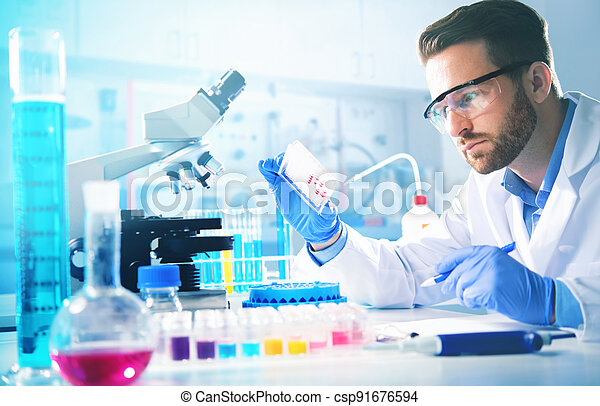 Medical doctor or biotechnology research scientist working in the laboratory - csp91676594