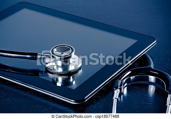 medical stethoscope on modern digital tablet pc in laboratory on wood table - csp18577488