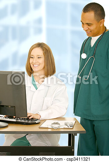 Medical Team Working On Computer - csp3411321
