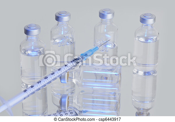 Medical Vials with Syringe - csp6443917
