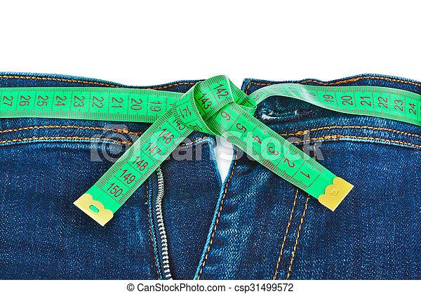 Jeans y cinta métrica - concepto de adelgazamiento - csp31499572