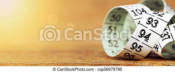 Pérdida de peso, dieta, midiendo la cinta - csp56979798