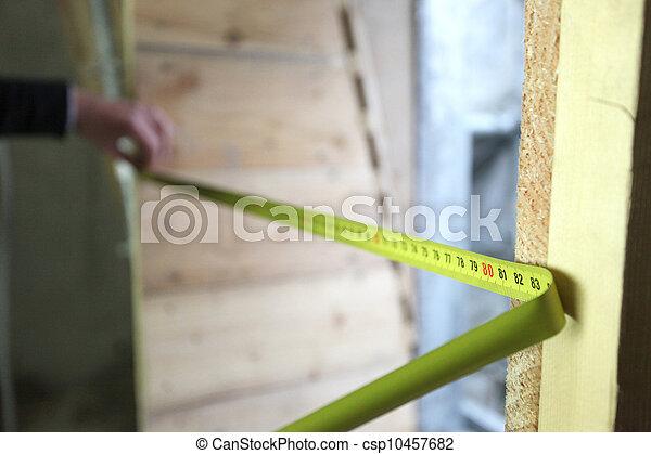 La cinta de medir se está extendiendo - csp10457682