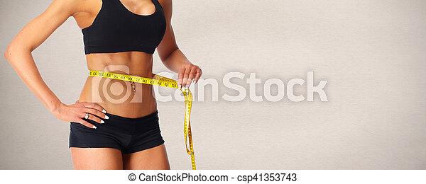 Abdomen con cinta métrica. - csp41353743