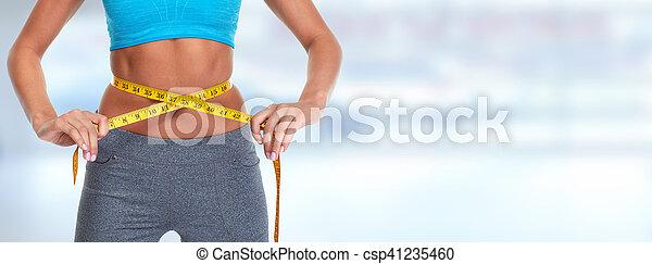 Abdomen con cinta métrica. - csp41235460