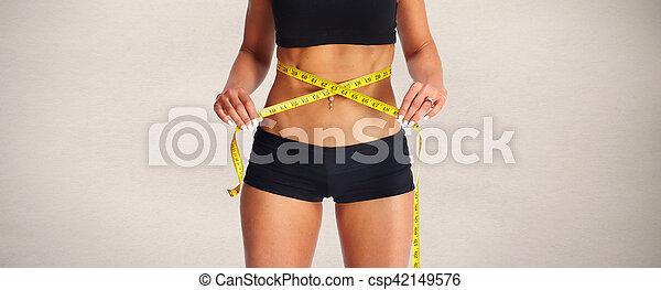 Abdomen con cinta métrica. - csp42149576