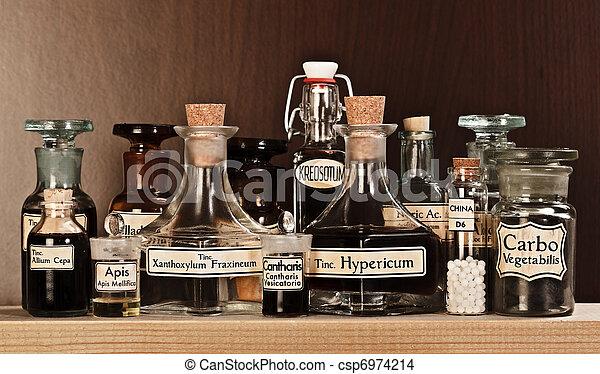 Varias botellas de farmacia de medicina homeopática - csp6974214