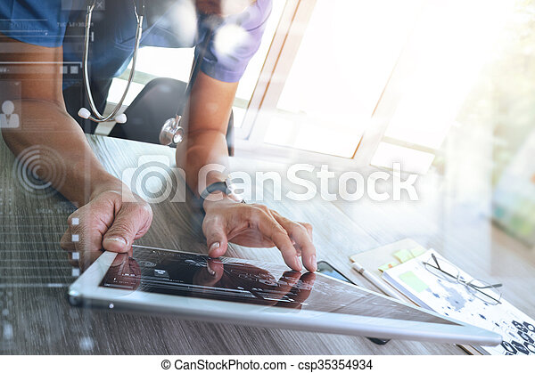 Medicine doctor hand working with modern digital tablet computer interface as medical network concept - csp35354934