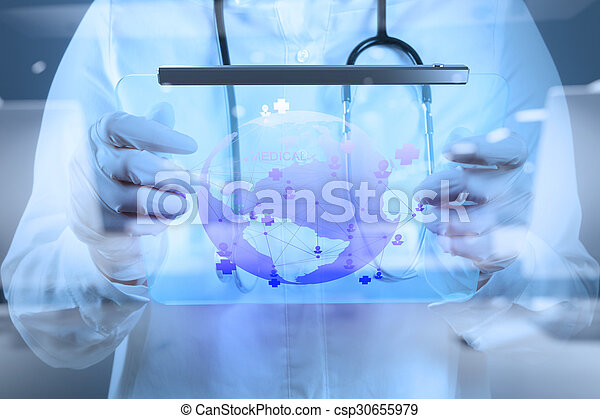 Medicine doctor working with modern computer interface as medical network - csp30655979