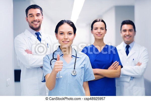medics or doctors at hospital showing thumbs up - csp48925957