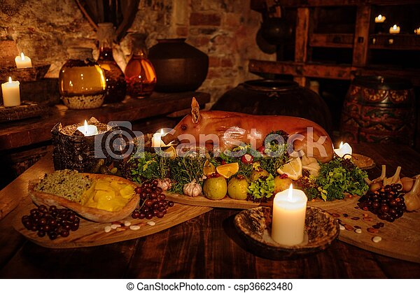 Medieval ancient kitchen table with typical food in royal for Art culture and cuisine ancient and medieval gastronomy