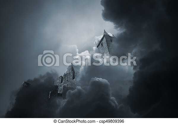 Mysterious medieval granite castle in the middle of the clouds
