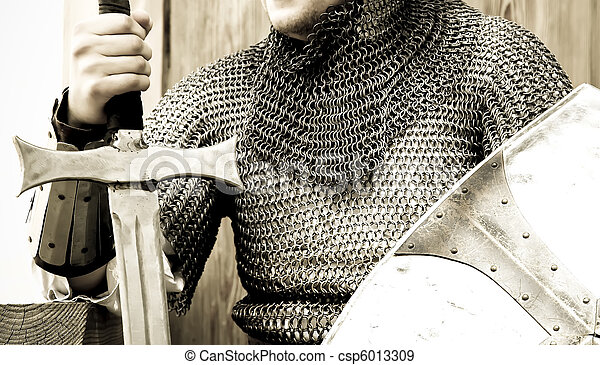 Medieval crusader knight with sword and shield. - csp6013309