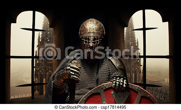 Medieval khight in the armor with the sword and helmet - csp17814495