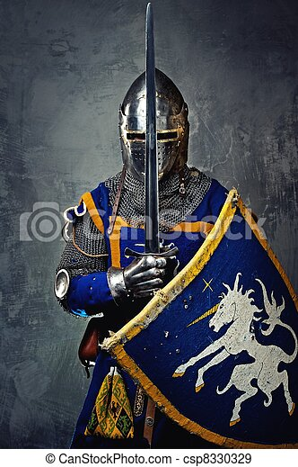 Medieval knight on grey background. - csp8330329