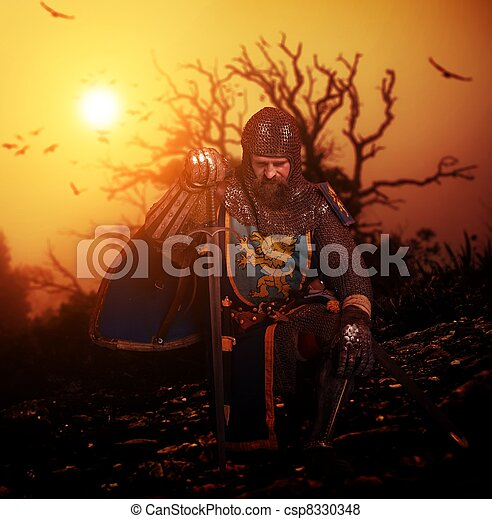 Medieval knight on his knee. - csp8330348