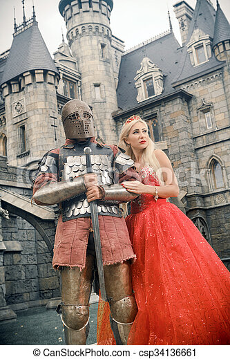 Medieval knight with his beloved lady. - csp34136661