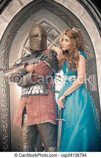 Medieval knight with his beloved lady.  - csp34136794