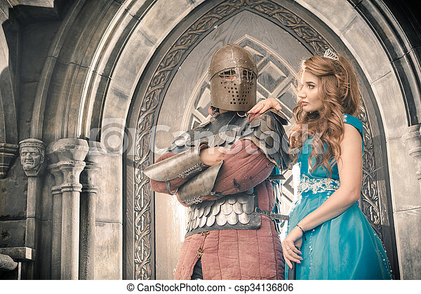 Medieval knight with his beloved lady.  - csp34136806