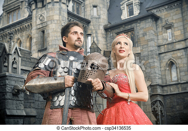 Medieval knight with his beloved lady. - csp34136535