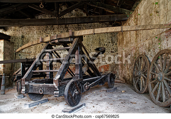 Medieval siege weapons, catapult with bow engine. - csp67569825