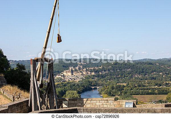 Medieval trebuchet at Chateau de Castelnaud, medieval fortress at Castelnaud-la-Chapelle, Dordogne, Aquitaine, France - csp72896926