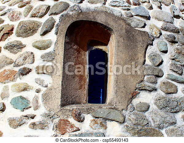 Medieval window on a church wall - csp55493143