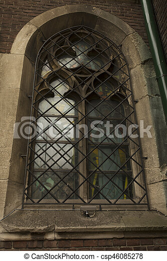 Medieval window on the facade of the cathedral in Lviv - csp46085278