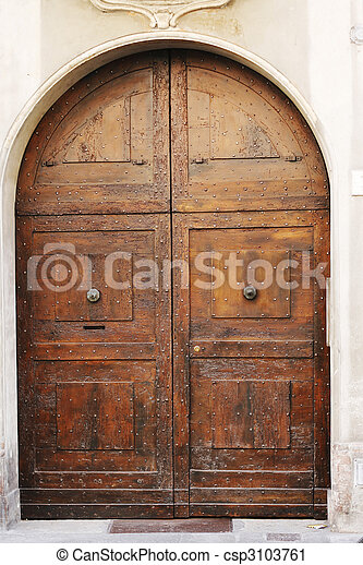 Medieval wooden door - csp3103761 & Medieval wooden door. Big wooden medieval door of old italian convent.