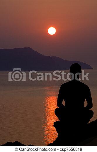 meditation at the sunset. - csp7556819