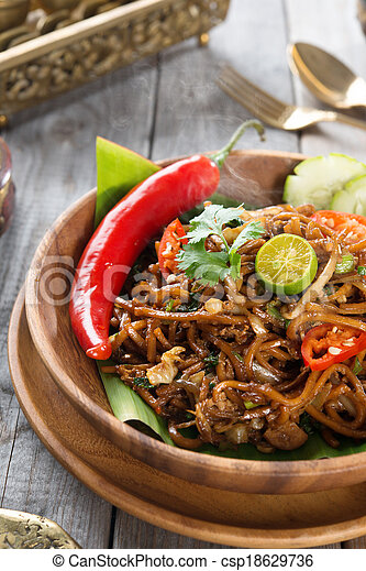 Mee goreng mamak or mi goreng indonesian and malaysian cuisine spicy fried noodles with wooden dining table setting. fresh hot with steamed smoke. & Mee goreng mamak or mi goreng indonesian and malaysian cuisine ...