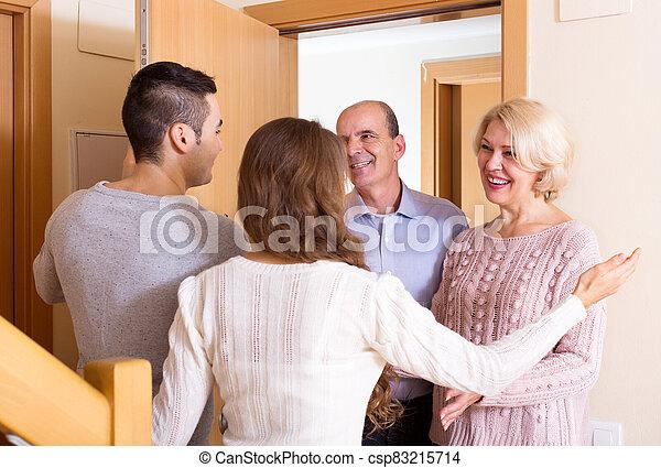 meeting at the door - csp83215714