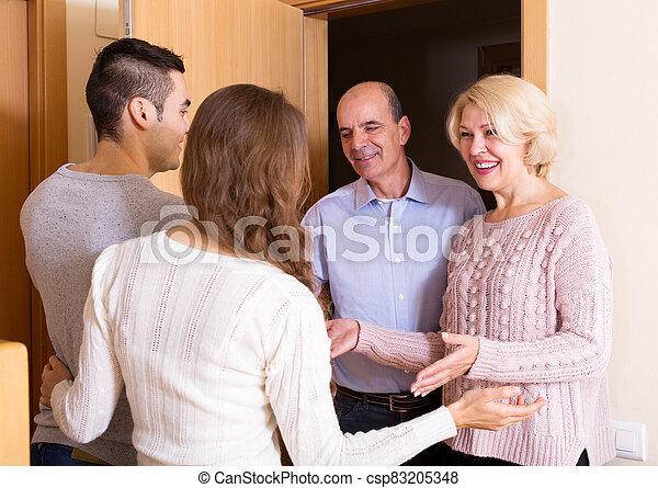 meeting at the door - csp83205348