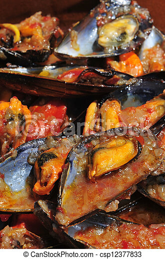 mejillones a la marinera, spanish mussels in marinara sauce - csp12377833