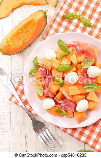 melon salad with mozzarella and prosciutto - csp54616233