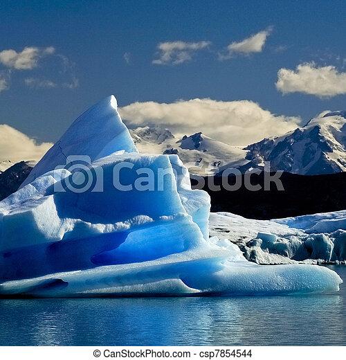 melting iceberg from dyeing glacier drifting away on Argentino lake, Patagonia, Argentina - csp7854544