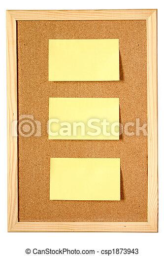 Memo notes stuck on a cork notice board - csp1873943