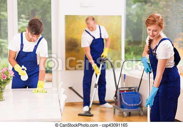 Men and woman cleaning apartment - csp43091165