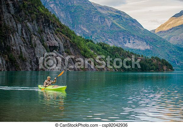 Men in a Kayak on Glacial Lake in the Norway - csp92042936