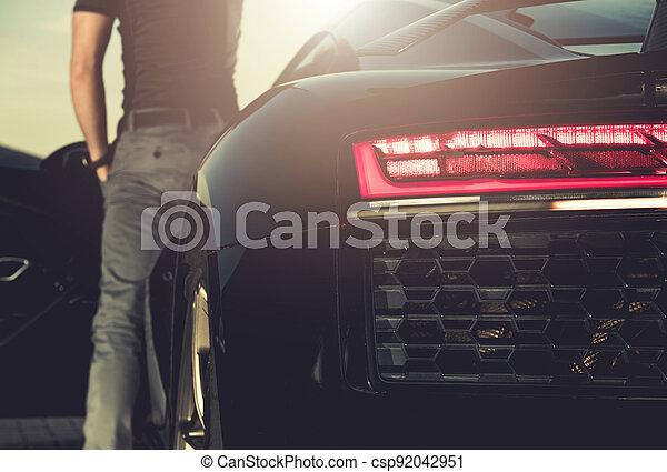 Men Leaving His Exotic Sporty Car - csp92042951