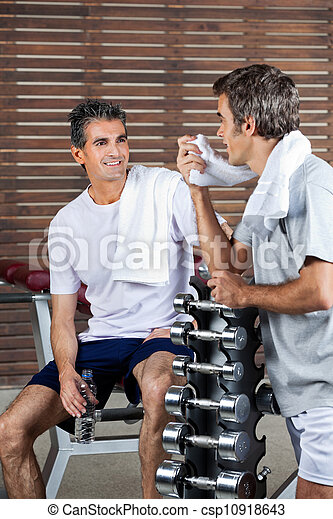 Men Looking At Each Other After Work Out - csp10918643