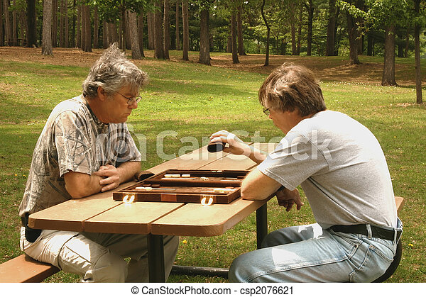 men playing backgammon - csp2076621