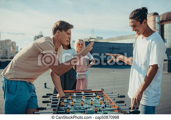 men playing rock-paper-scissors - csp50870998