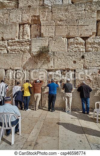 Men praying at the