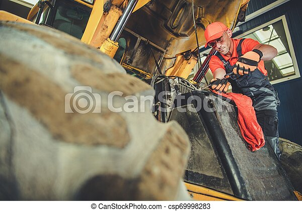 Men Repairing Small Dozer - csp69998283