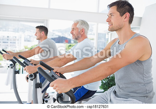 Men working out on exercise machine - csp18127631