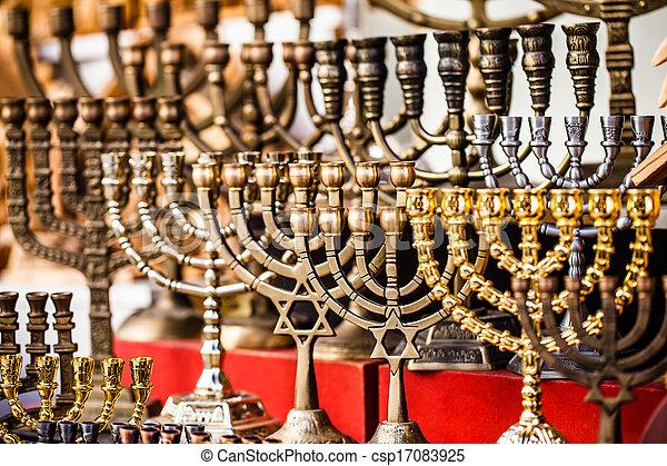 Menorah for sale in shop in the Jerusalem old city market. - csp17083925