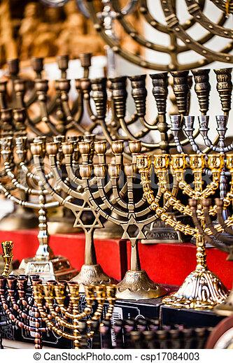 Menorah for sale in shop in the Jerusalem old city market. - csp17084003