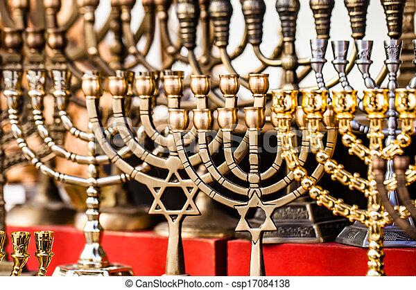 Menorah for sale in shop in the Jerusalem old city market. - csp17084138