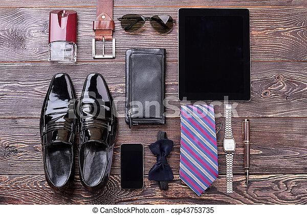 Men's accessories on wooden background. - csp43753735